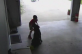 Boy sneaks into garage play dog