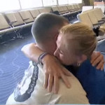 Oliver and Sgt. Hansen embrace at the airport