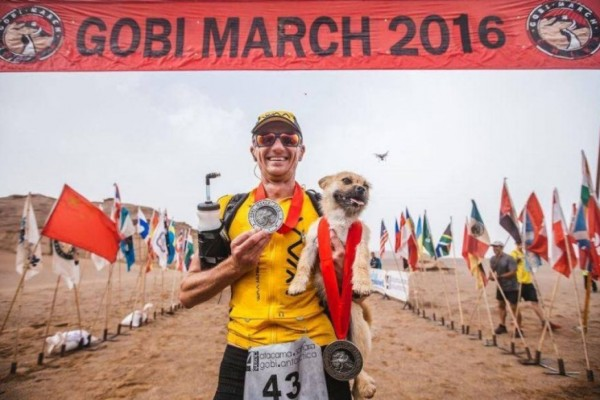 Gobi and Dion Leonard Proudly Display Their Medals At The End Of The Finish Line