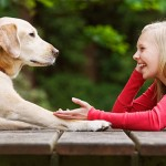 girl_relaxing_while_talking_to_dog