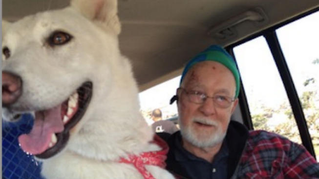 Missy the dog is reunited with owner Clem following Thursday's tornado in Chicago