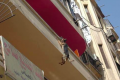 Dog hangs from balcony Egypt