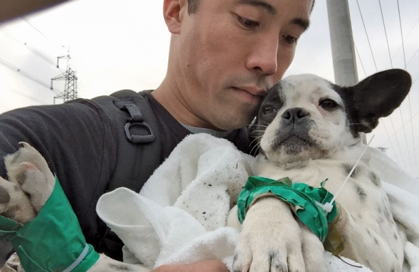 man holds dog he rescued