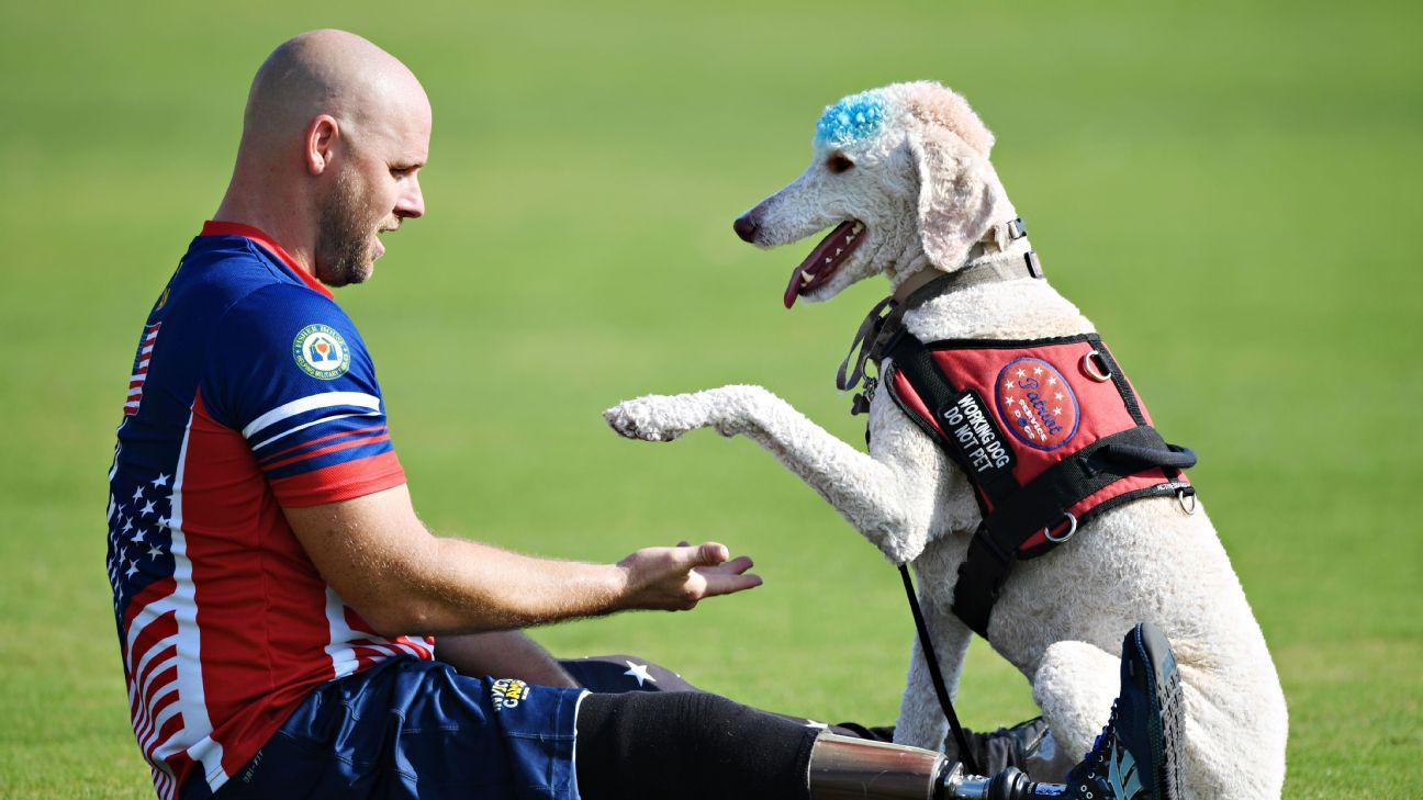Brett Parks and his dog Freedom at Invictus